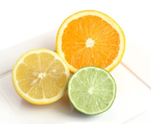 Half and orange, lemon and lime on square white plate with white background. : Stock Photo