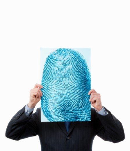 Businessman with thumbprint for head : Stock Photo