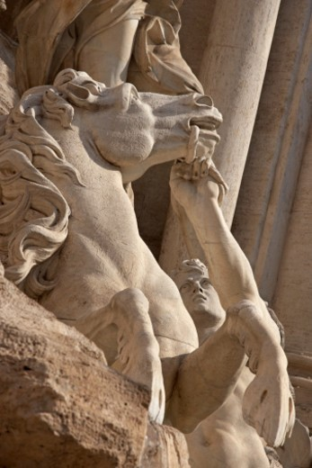 Stock Photo: 1672R-32526 Statue of a horse and a Triton as part of the Trevi Fountain in Rome