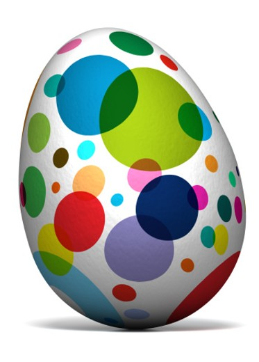 Stock Photo: 1672R-32578 An Easter egg decorated with multicoloured spots on a white background. Close up
