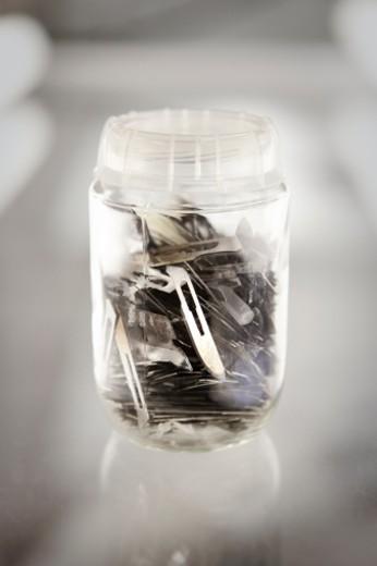 scalpel blades in jar : Stock Photo