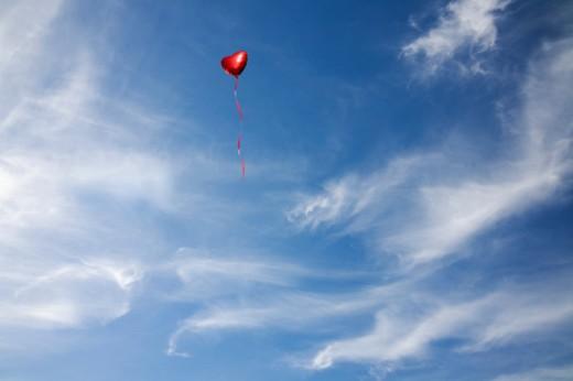Heart Balloon in a blue sky : Stock Photo