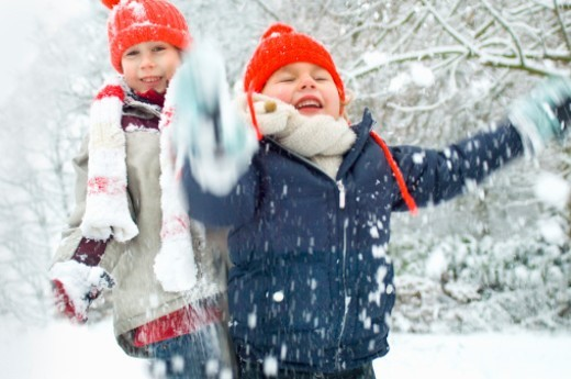 2 boys playing in the snow : Stock Photo