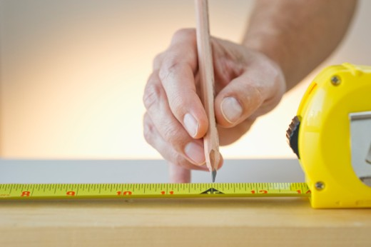 Stock Photo: 1672R-34827 measuring with measuring tape and pencil