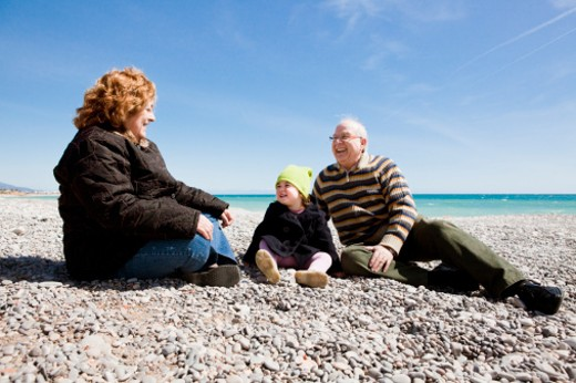 grandparent with her baby girl at the beach : Stock Photo