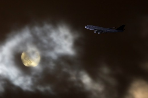 Jetliner flying at night. : Stock Photo