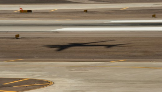 Stock Photo: 1672R-36228 Transportation, Aircraft's Shadow On Take Off