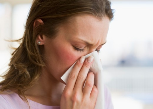 Stock Photo: 1672R-36625 Woman blowing her nose