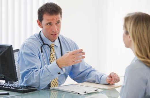 Doctor consultation in office : Stock Photo