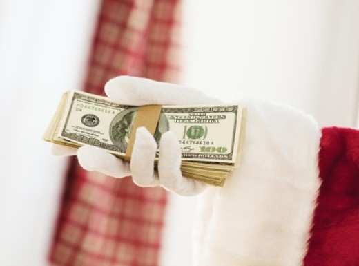Santa Claus holding stack of hundred dollar bills  : Stock Photo