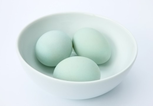 Three fresh, newly laid, free range, organic Indian runner duck eggs in white bowl on white background. : Stock Photo