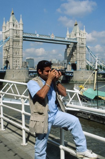 Photographer Near Tower Bridge - London, UK : Stock Photo