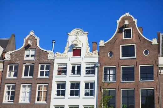 Typical 17th century Dutch gabled houses that line the canals of Amsterdam, Netherlands : Stock Photo