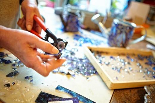 glass mosaics in her home studio : Stock Photo