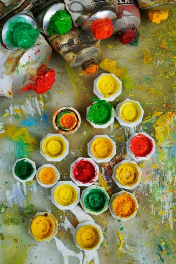 Bunch of opened paint tubes on palette, high-angle view : Stock Photo