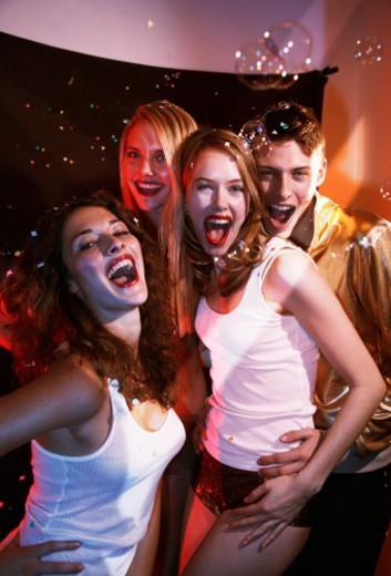 Stock Photo: 1672R-41317 Group of friends laughing and dancing on a party