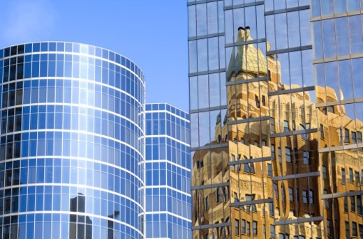 Marine building reflected in office building, Vancouver, BC, Canada : Stock Photo