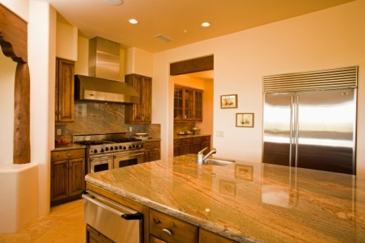 Modern kitchen with granite counter tops in southwestern ranch house with commercial range and butler's pantry : Stock Photo