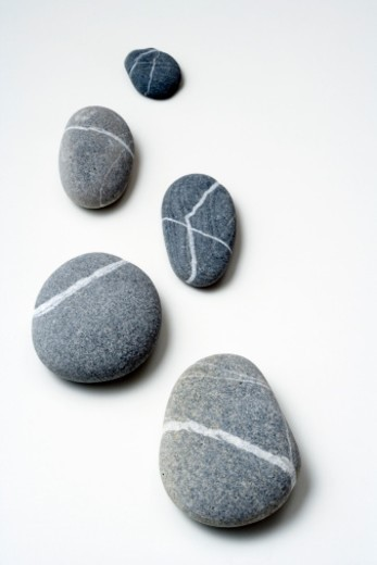 Stock Photo: 1672R-42838 Five Stones on White Background.