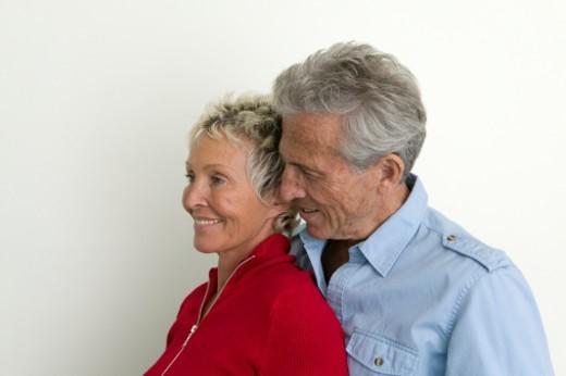 Senior couple embracing, smiling : Stock Photo