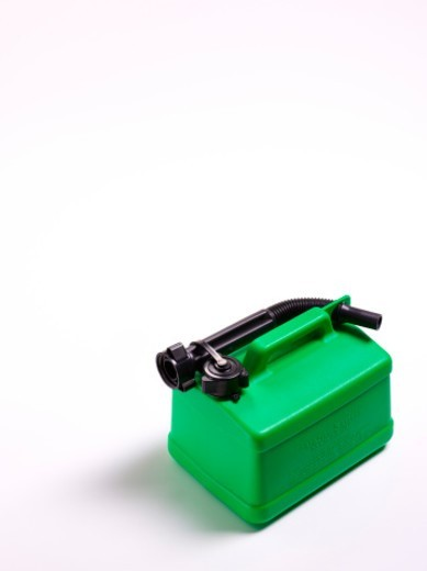 Green gas can on white background. : Stock Photo