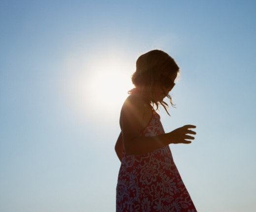 Silhouette of girl on beach. : Stock Photo
