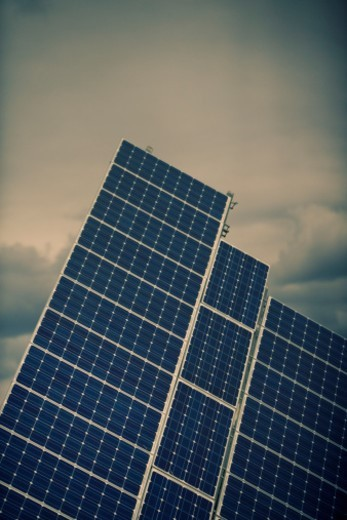 Solar energy power plant showing detail of sun tracking photovoltaic arrays : Stock Photo