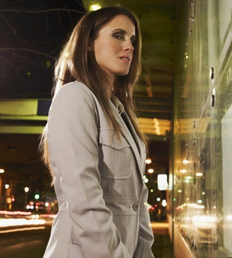 Business woman at night on urban street : Stock Photo
