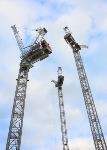 Stock Photo: 1672R-44680 Three white cranes against a blue sky