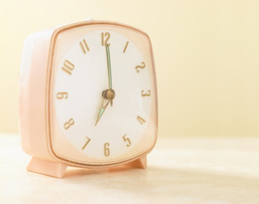 Stock Photo: 1672R-44845 Pink clock close up.