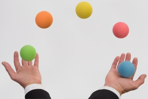Stock Photo: 1672R-4556 Man juggling various colored balls (Digital Composite)