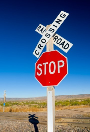 USA. New Mexico. Route 66. near Montoya. Railroad Crossing and sign. : Stock Photo