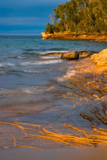 Stock Photo: 1672R-46219 Sunset light on Lake Superior at Miners Beach; Pictured Rocks National Lakeshore, MI