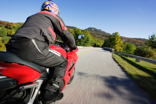 YM7423bAL  United States, North Carolina.  Blue Ridge Parkway National Park.  View of motorcycle in action on Parkway and Grandfather Mountain. : Stock Photo