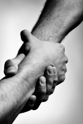 two interlocking male hands : Stock Photo