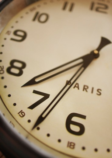 Stock Photo: 1672R-47422 antique wall mounted clock with the word paris