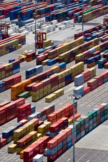 Aerial view of shipping containers in storage yard awaiting distribution : Stock Photo