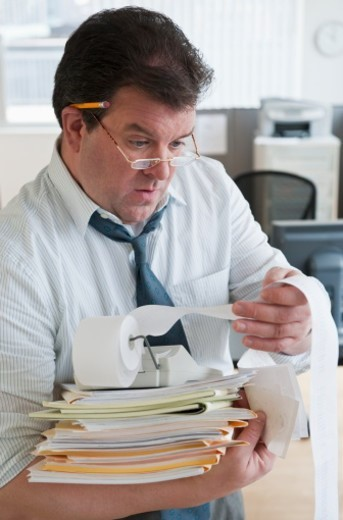 accountant scrutinizing numbers : Stock Photo