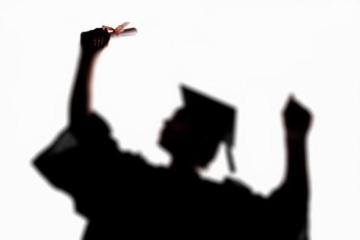 Shadow of female graduate : Stock Photo