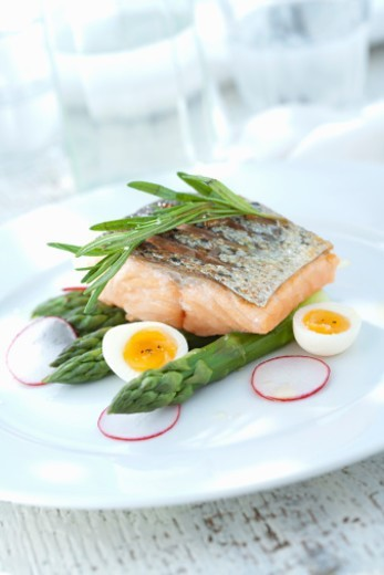 Grilled salmon,asparagus and quail egg salad. : Stock Photo