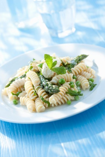 Fusilli pasta with asparagus, peas and creme fraiche. : Stock Photo