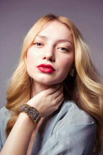 Portrait of a woman wearing jewelry : Stock Photo