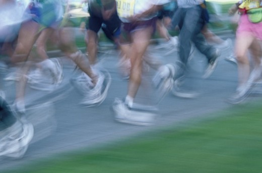 Stock Photo: 1672R-5177 People running in marathon, low section (long exposure)