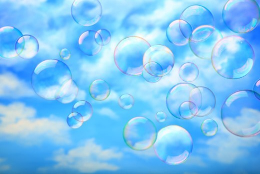 multiple bubbles floating in clear sky : Stock Photo