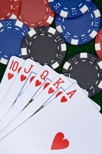 Stock Photo: 1672R-53335 Close-up of poker chips and  playing cards on green felt