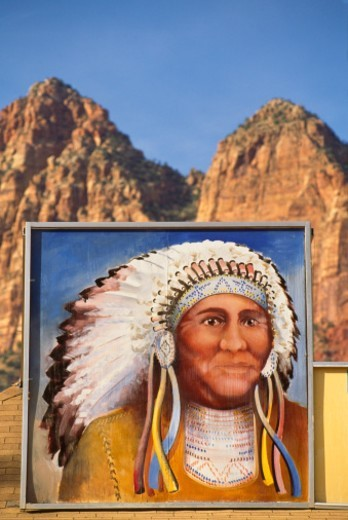 Stock Photo: 1672R-53676 USA, Utah, painted portrait of Indian man on building in mountains