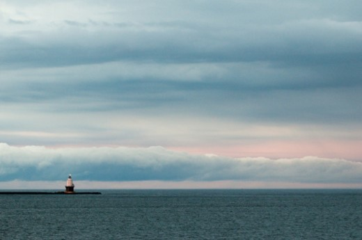 Harbor of Refuge Lighthouse under storm clouds. : Stock Photo