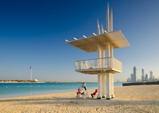 Stock Photo: 1672R-54780 United Arab Emirates, Abu Dhabi, Corniche, Beach Lifeguards and Skyline