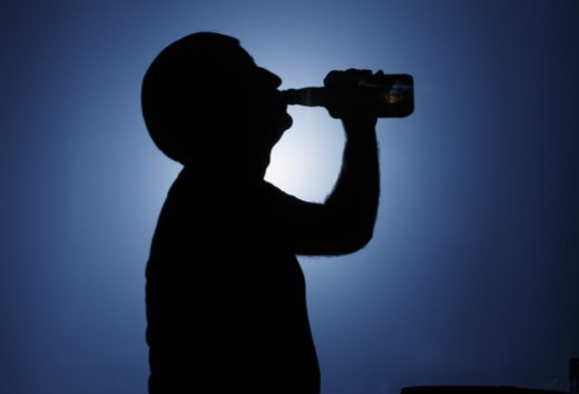 Stock Photo: 1672R-55536 Man drinking alcohol. Silhouette.