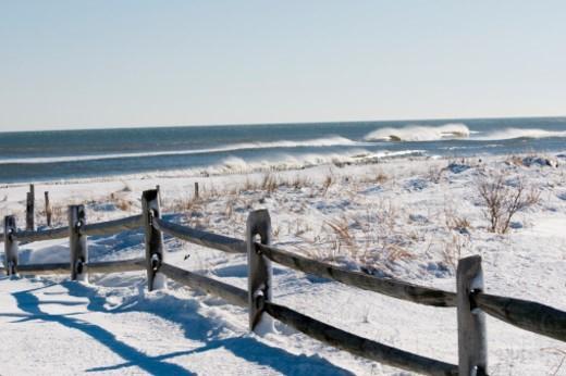 Stock Photo: 1672R-55667 Snow covered sand dunes after a winter storm.